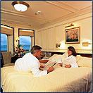 man and woman laying on bed in luxurious cabin